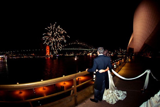 The newlyweds enjoy a fireworks display near the Harbour Bridge! Very romantic!